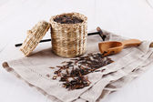 Organic black wild rice in a straw basket on a white wooden background — Stock Photo