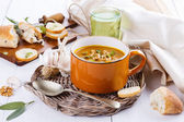 Pumpkin soup with rustic bread on white background — Stock Photo