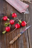 Fresh organic radish on wooden background — Stock Photo