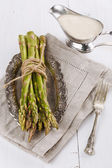 Fresh asparagus on a rustic wooden background — 图库照片