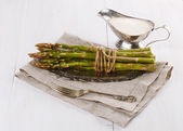 Fresh asparagus on a rustic wooden background — Stock Photo