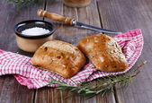 Ciabatta bread on rustic wooden background — Stockfoto