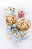 Buttered popcorn in bowls over white background — Foto de Stock