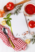 Cooking concept. Recipe book and ingredients for cooking tomato  — Stock Photo