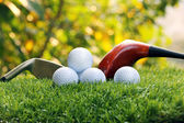Golf balls and Drivers on green grass — Stock Photo