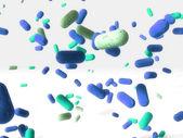 Blue drugs falling down — Стоковое фото