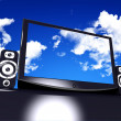 Stock Photo: Black stylish glossy widescreen TFT display with blue sky and clouds