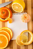 Citrus with empty cookbook close up — Foto Stock