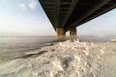 A metal bridge over the icy — Stock Photo