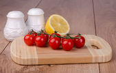 Cherry tomatoes on a cutting board — Stock Photo