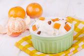 Ice cream with mandarin and almond — Stock Photo