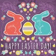 Greetings card with easter eggs and two rabbits — Stock Vector #43047347