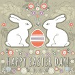 Greetings card with easter eggs and two rabbits — Stock Vector #43050623