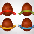 Four easter eggs over grey background — Stock Vector #43280609