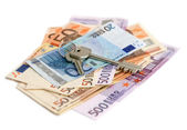 Euro banknotes with keys — Stock Photo