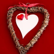 Wooden Heart with Red Heart and Ribbon — Stock Photo #40041249