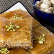 Baklava with a Bowl of Pistachios — Stock Photo