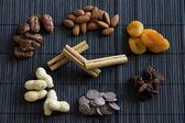 Dried Fruit, Nuts, Chocolate and Cinnamon — Stock Photo