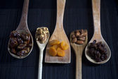 Dried Fruit and Nuts on Wooden Spoons — Stock Photo