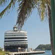 Stock Photo: Cruiseship docked in tropical port