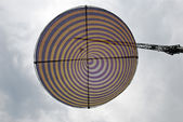 Disk suspended in the sky — Stock Photo