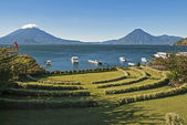 Lake Atitlan with volcanoes in background — Stock Photo