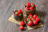 Strawberries in cups and on the plate — Stock Photo