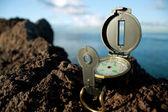Compass on rock — Stock Photo