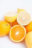 Group cut lemon and orange isolated on white background — Stock Photo
