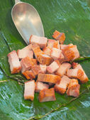 Fried streaky pork place on banana leaf — Stockfoto
