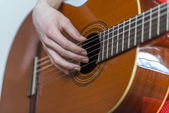 Female hands playing guitar — Stock Photo