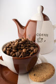 Cup of roasted brown coffee beans — Stockfoto