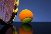 Tennis Ball for children with tennis racket on blue background — Foto de Stock