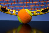 Tennis Ball for children with tennis racket on blue background — Stock Photo