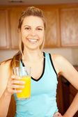 Woman orange juice — Stockfoto