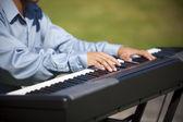 Playing a keyboard — Stock Photo