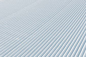 Snow groomer tracks — Stock Photo