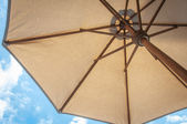 Summer time under the umbrella — Stock Photo