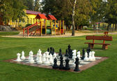 Playground in the morning sun with a chess — Stock Photo