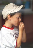 Little boy slobbering stick after ice lollies — Photo