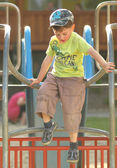 Child on climbing frame in the playground — Stock Photo