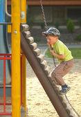 Climbing boy on the playground — Stock Photo