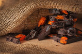 Dark chocolate with raisins and dried apricots — Stock Photo