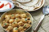 Kashmiri dum aloo is a deep fried baby potatoes cooked in yogurt — Stock Photo