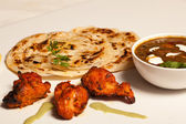 Paratha with paneer masala and chicken kebab. — Stock Photo