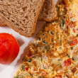 Brown bread is made with significant amounts of wheat, omelette — Stock Photo #49827029