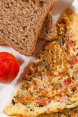 Brown bread is made with significant amounts of wheat, omelette  — Stock Photo