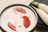 Mooli ka raita is a combination of yogurt mix with spices and grated radish — Stock Photo