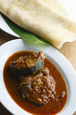Kerala fish curry - fish in a tangy coconut curry — Stock Photo