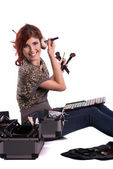 Happy young make up artist with her tools — Stock Photo
